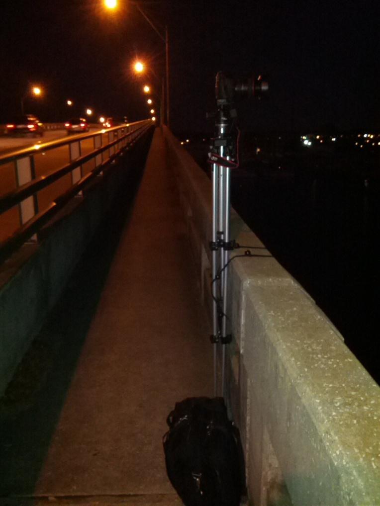 Camera on tripod bungeed to bridge