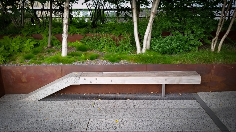 Bench grows out of the floor. Reminiscent of a railway junction.