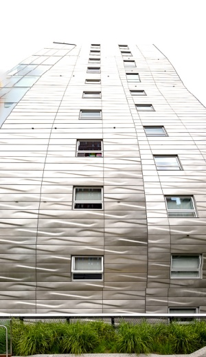 This wavy gravy metal plated building butted right up against the Highline.