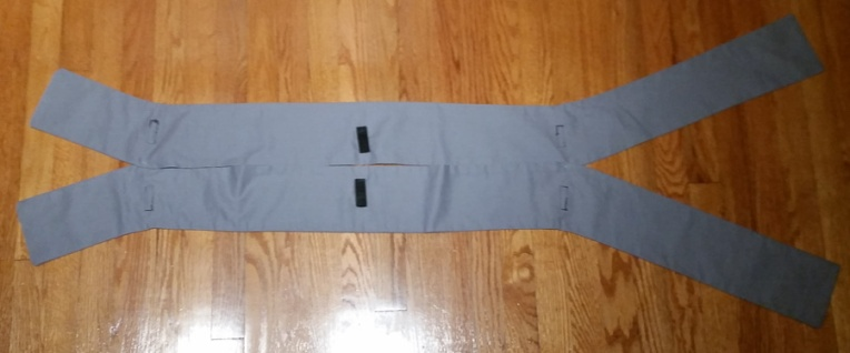 Underside of finished tabards. Note velcro to attach to shirt shoulder. Tabards are tacked together with stitches where angled pieces meet the straight section.