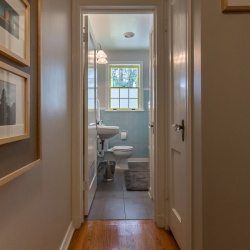 Yellow window serves as a focal point. I made a transom for the transition between flooring materials but we found that we didn't need it.