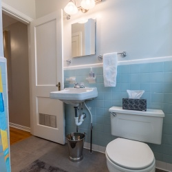 I wish I didn't have to caulk the toilet but it sits enough above the floor that it is necessary. Note that it is only caulked on the front and one side. That way if it ever leaks we will see it and can correct the problem right away.